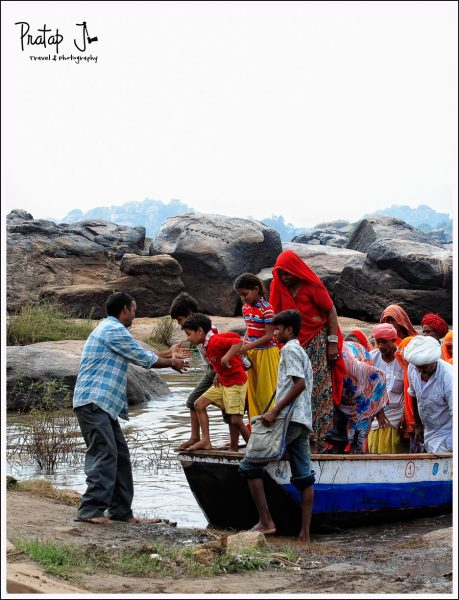 Tourists Alight from a Boat at the Banks of Tungabadra