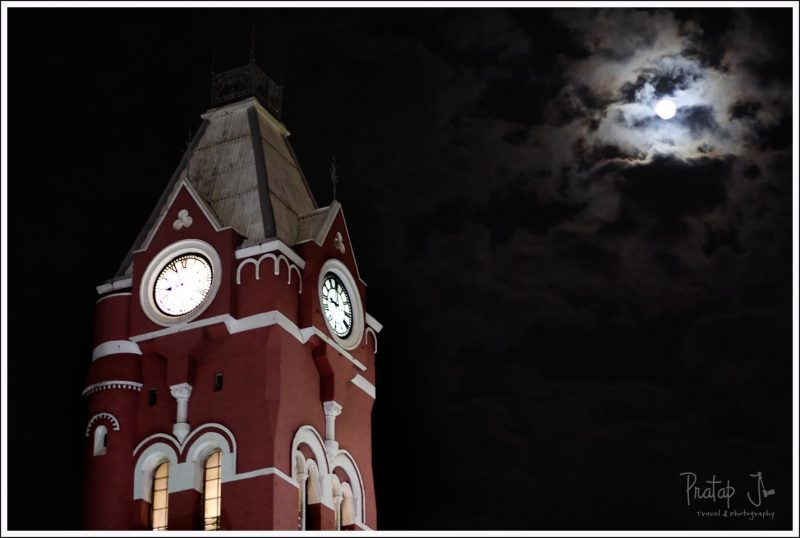 A full moon over the clock at Chennai Central Railway Station