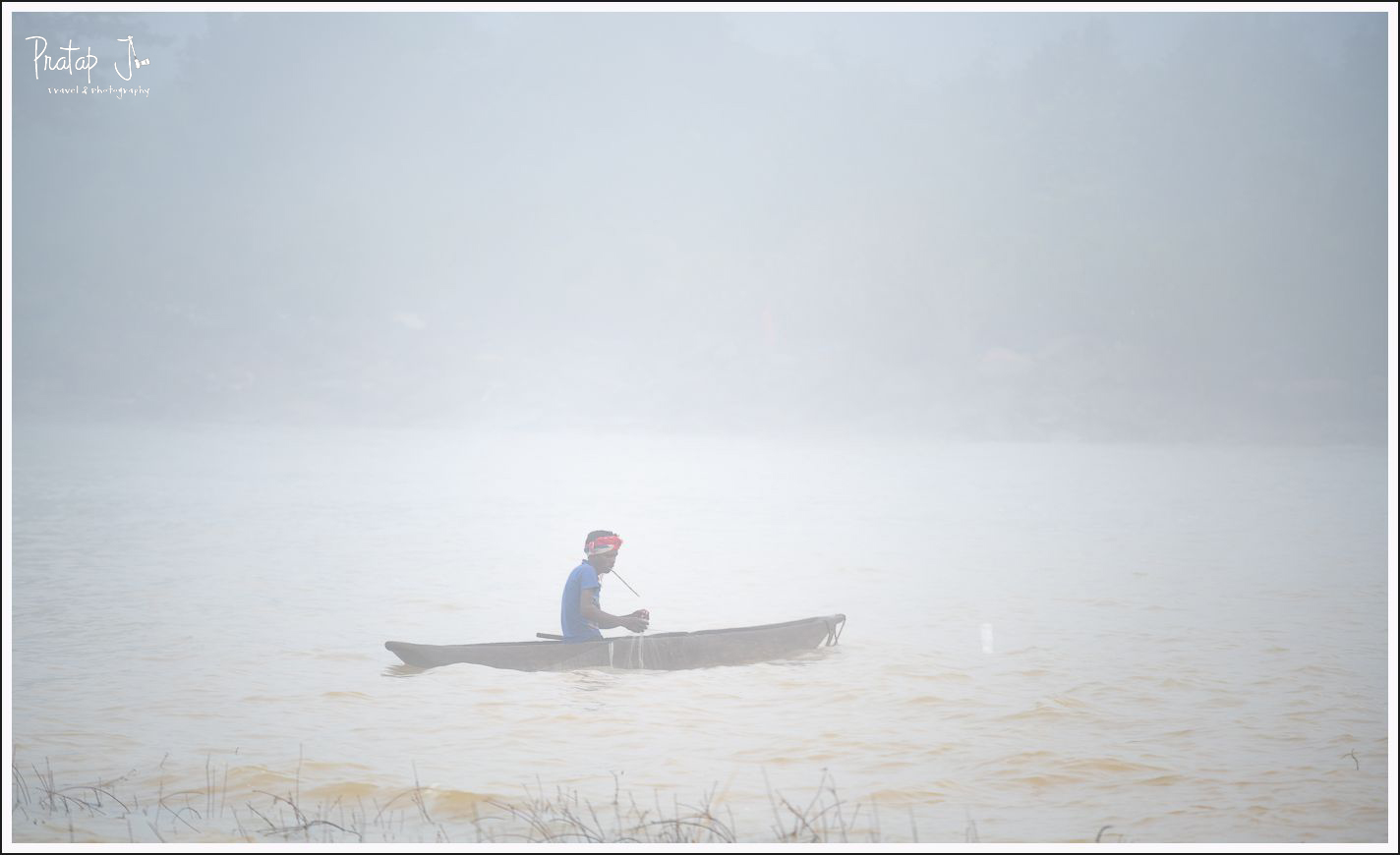 Fisherman on a boat at Chitrakote