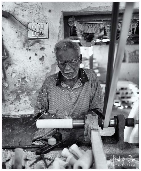 Artist making wooden toys