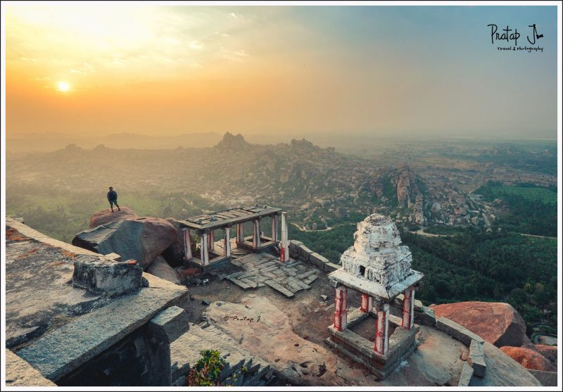 Man stands on a rock at Mathanga during sunrise