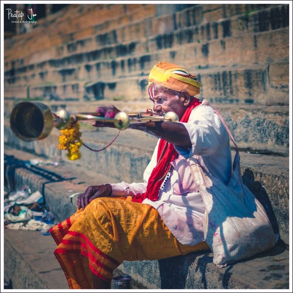 Dassayas blow a long trumpet quite frequently