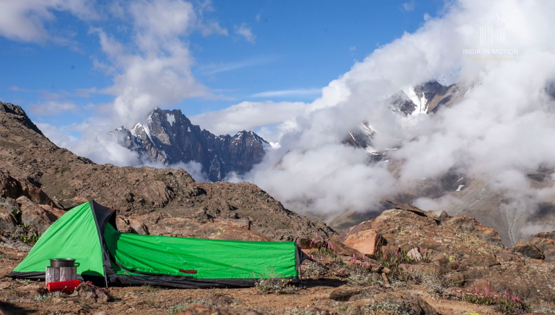 Green tent with Snow Clad Peaks