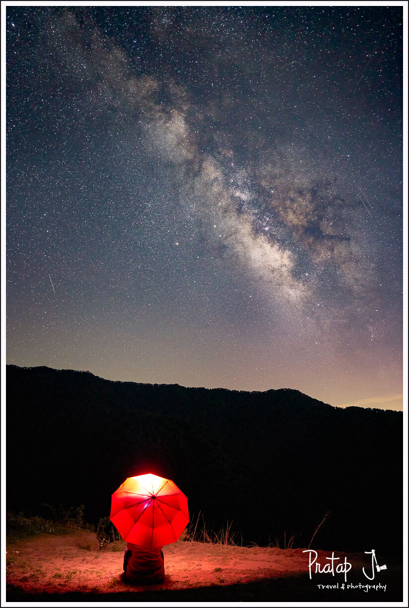 Red umbrella and Milky Way