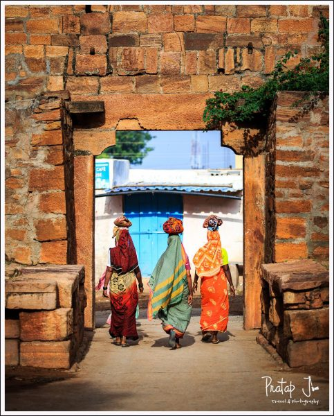 Women of Badami walking with pots on their heads