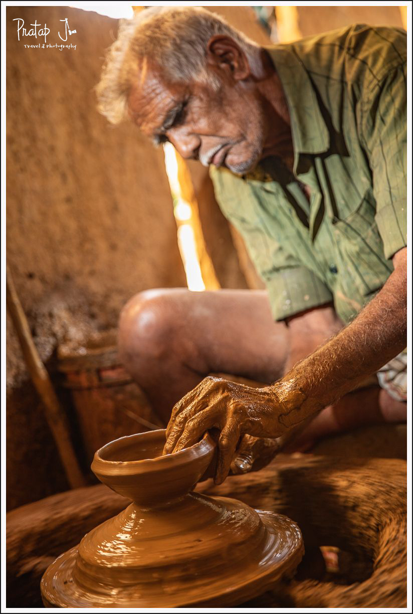 Potter making a clay pot on a traditional wheel