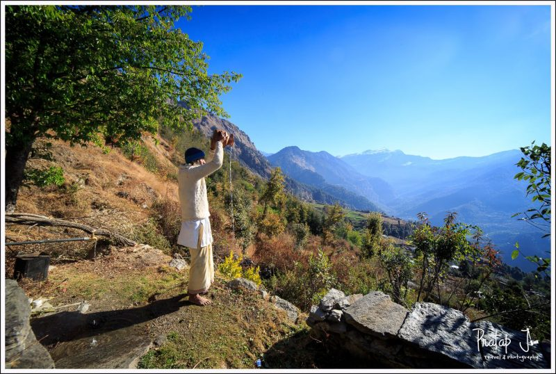 Priest offers prayers to the Himalayan mountains