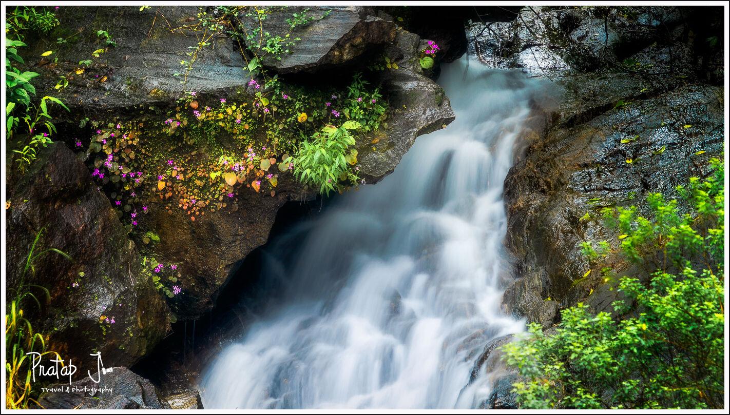 Monsoon waterfall at Charmadi
