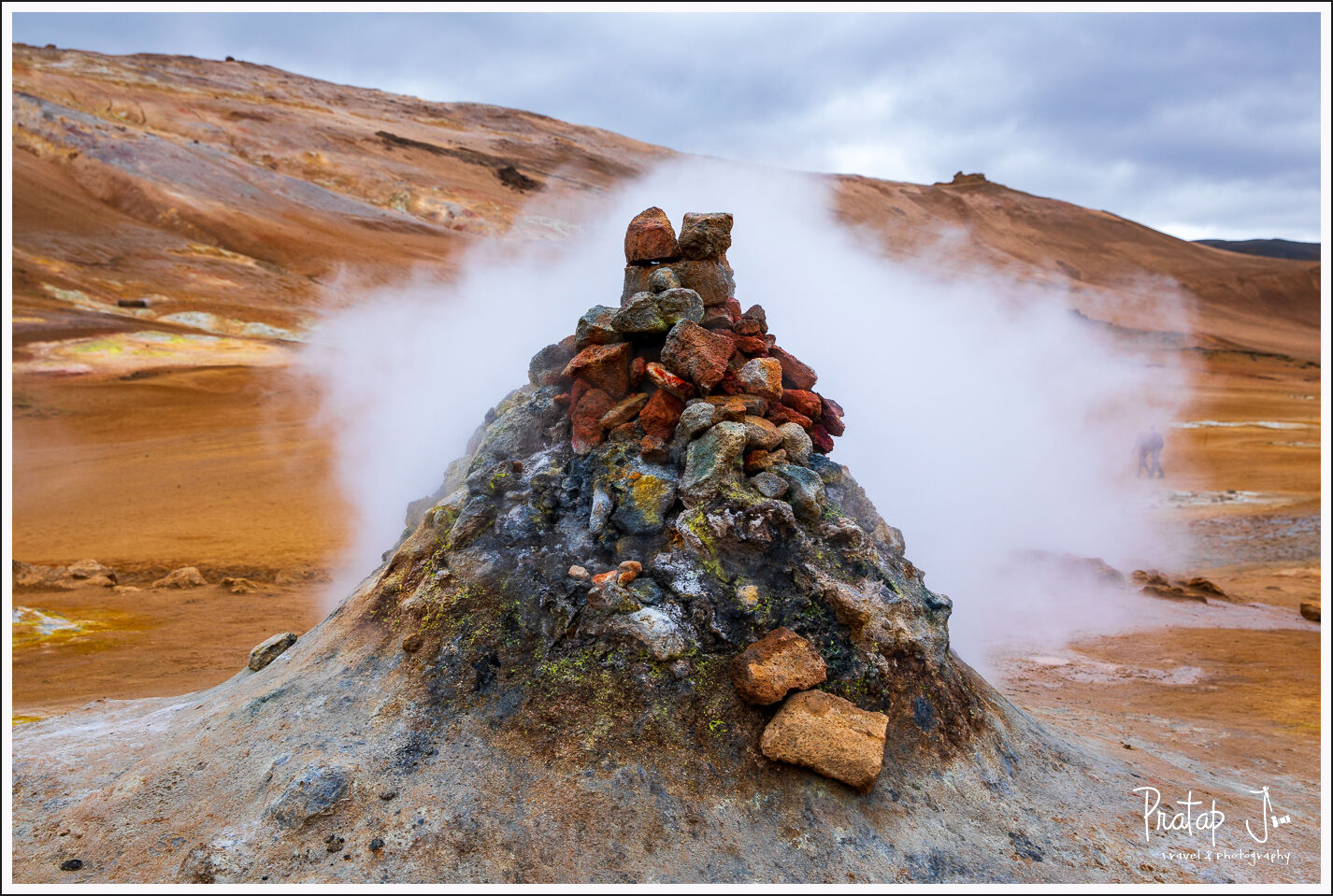Sulfuric acid smoke coming from below the earth in Iceland